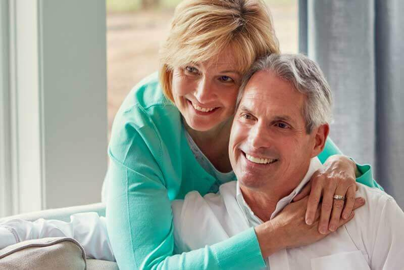 Man and Woman who have received periodontal therapy